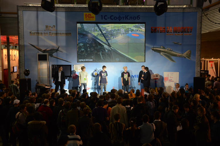 """Presentation of the special Battle of Britain in-game trailer on the main wall of the booth in the center of the exhibition."""