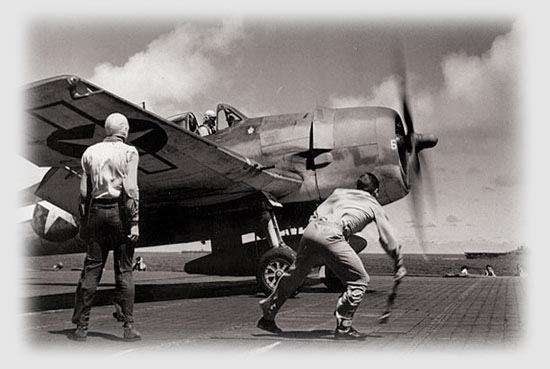 "F6F-3 ""Hellcat"" takes off from USS Lexington, during Gilberts operation, 1943."