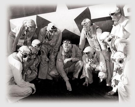 LCdr. Paul Buie briefs pilots of VF-16 aboard USS Lexington, November-December 1943