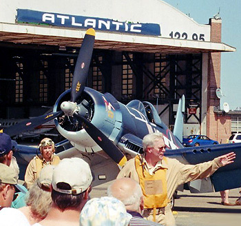 """Corsair owner Tom Duffy demonstrates wartime test pilot procedures before climbing into his FG-1D, """"Marine's Dream,"""" for an orientation flight."""
