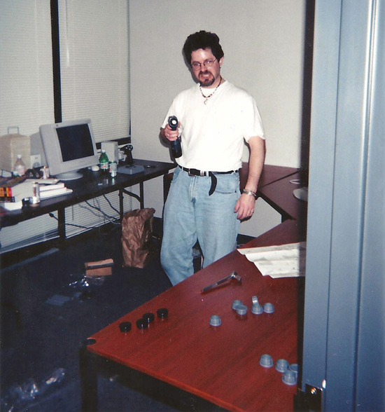 John Paquin putting his office furniture together
