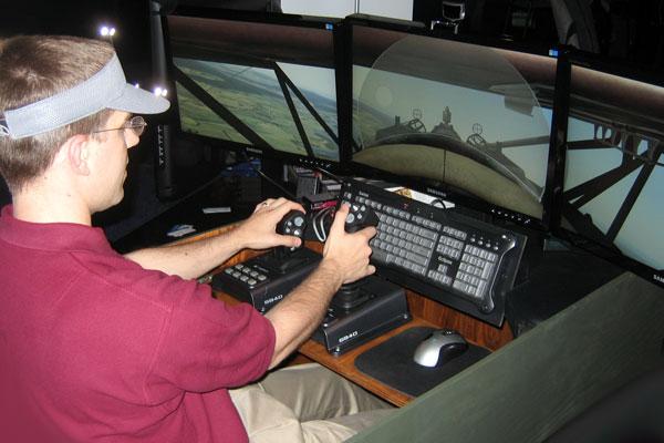 Joe at the controls of Rise of Flight