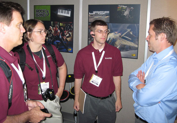 Chipwich, *Panther* and Joe discuss Mad Catz products with Senior Product Marketing Manager Nicki Repenning.