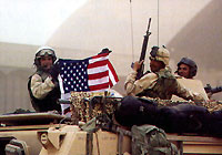 PHOTO CREDIT: Soldiers with flag: Brant Sanderlin - Atlanta Journal-Constitution