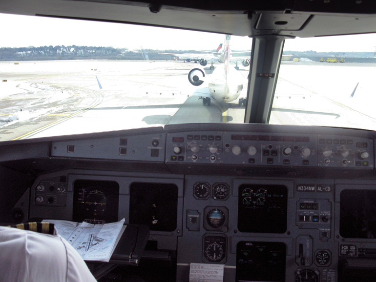 "On the Airbus 320 jumpseat in line for launch from KMSP. ""Could you guys please hurry up? I have a LAN to attend!"""